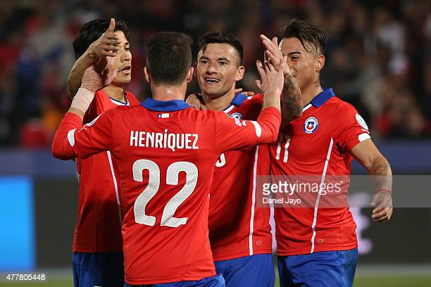 Charles Aranguiz of Chile celebrates with teammates after scoring the third goal of his team during the 2015 Copa America Chile Group A match between...