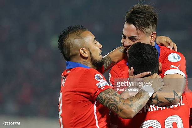 Charles Aranguiz of Chile celebrates with teammates after scoring the opening goal during the 2015 Copa America Chile Group A match between Chile and...