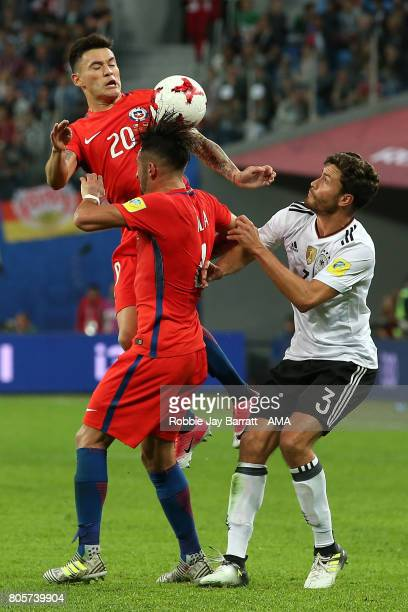 Charles Aranguiz of Chile competes with Jonas Hector of Germany during the FIFA Confederations Cup Russia 2017 Final match between Chile and Germany...