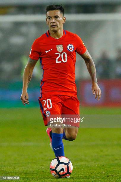 Charles Aranguiz of Chile drives the ball during a match between Chile and Paraguay as part of FIFA 2018 World Cup Qualifiers at Monumental Stadium...
