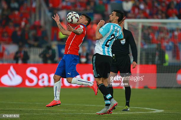 Charles Aranguiz of Chile fights for the ball with Javier Pastore of Argentina during the 2015 Copa America Chile Final match between Chile and...