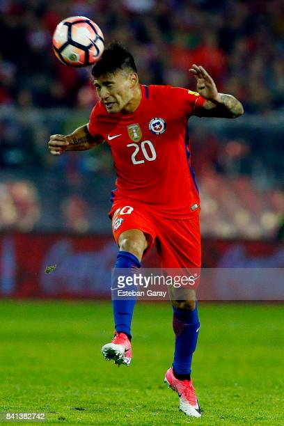 Charles Aranguiz of Chile heads the ball during a match between Chile and Paraguay as part of FIFA 2018 World Cup Qualifiers at Monumental Stadium on...