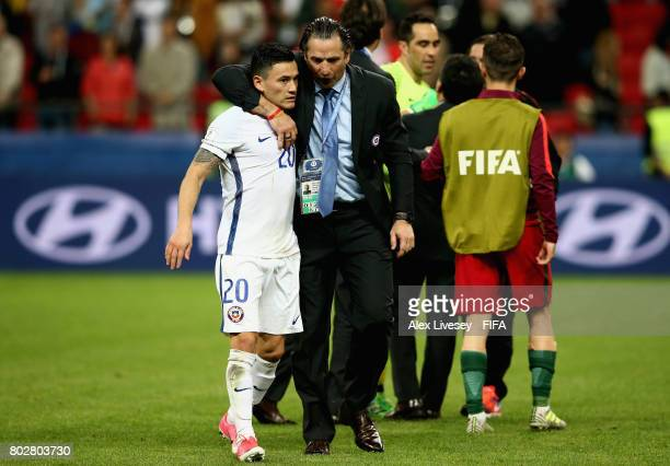 Charles Aranguiz of Chile is embraced by head coach Juan Antonio Pizzi after the FIFA Confederations Cup Russia 2017 SemiFinal between Portugal and...