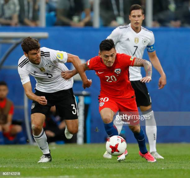 Charles Aranguiz of Chile national team and Jonas Hector of Germany national team during FIFA Confederations Cup Russia 2017 final match between...