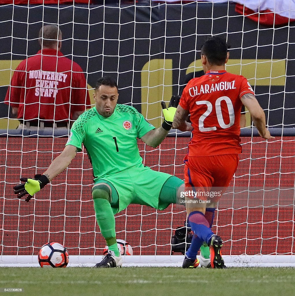 Charles Aranguiz #20 of Chile scores a goal past <a gi-track='captionPersonalityLinkClicked' href=/galleries/search?phrase=David+Ospina&family=editorial&specificpeople=4104267 ng-click='$event.stopPropagation()'>David Ospina</a> #1 of Colombia during a semi-final match in the 2016 Copa America Centernario at Soldier Field on June 22, 2016 in Chicago, Illinois.