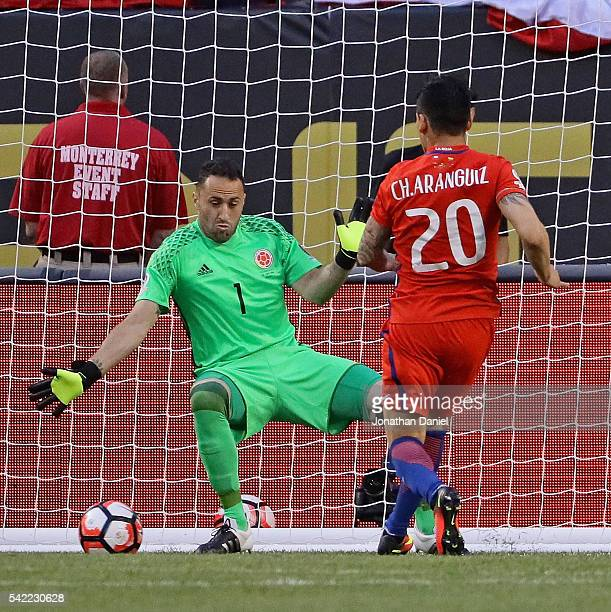 Charles Aranguiz of Chile scores a goal past David Ospina of Colombia during a semifinal match in the 2016 Copa America Centernario at Soldier Field...