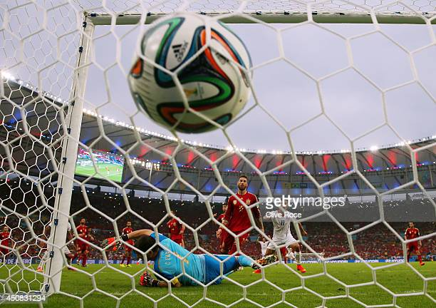 Charles Aranguiz of Chile scores the second goal past Iker Casillas of Spain during the 2014 FIFA World Cup Brazil Group B match between Spain and...
