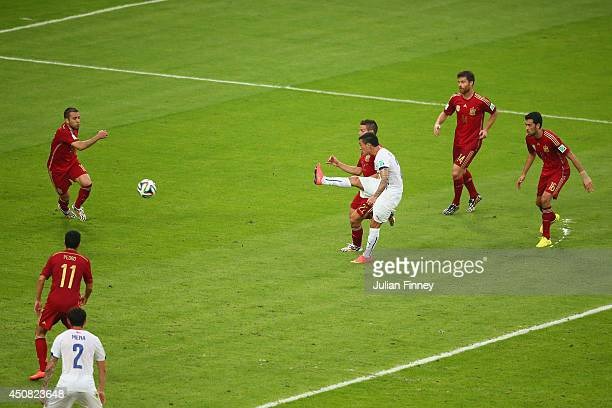 Charles Aranguiz of Chile shoots and scores his team's second goal during the 2014 FIFA World Cup Brazil Group B match between Spain and Chile at...