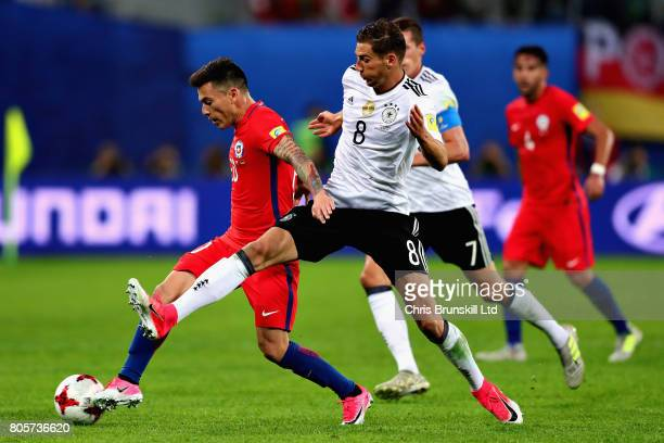 Charles Aranguiz of Chile tangles with Leon Goretzka of Germany during the FIFA Confederations Cup Russia 2017 Final match between Chile and Germany...