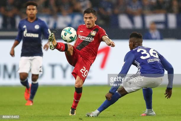 Charles Aranguiz of Leverkusen and Breel Embolo of Schalke battle for the ball during the Bundesliga match between FC Schalke 04 and Bayer 04...
