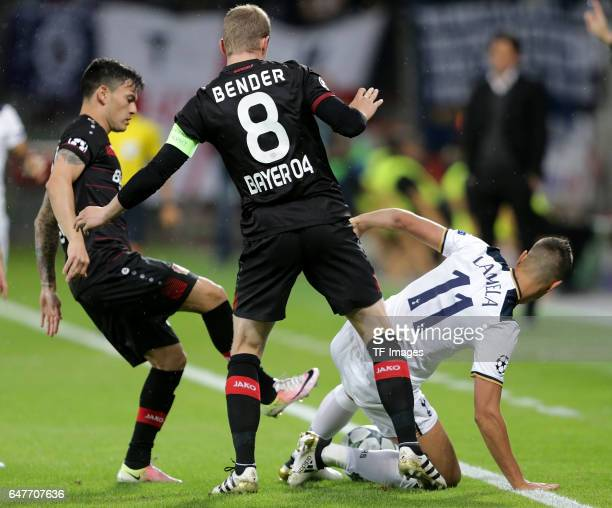 Charles Aranguiz of Leverkusen and Lars Bender of Leverkusen and Erik Lamela of Tottenham battle for the ball during the UEFA Champions League group...