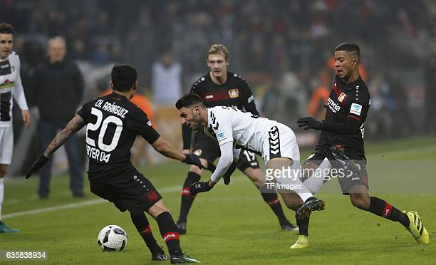 Charles Aranguiz of Leverkusen and Vincenzo Grifo of Freiburg and Benjamin Heinrichs of Leverkusen battle for the ball during the Bundesliga match...