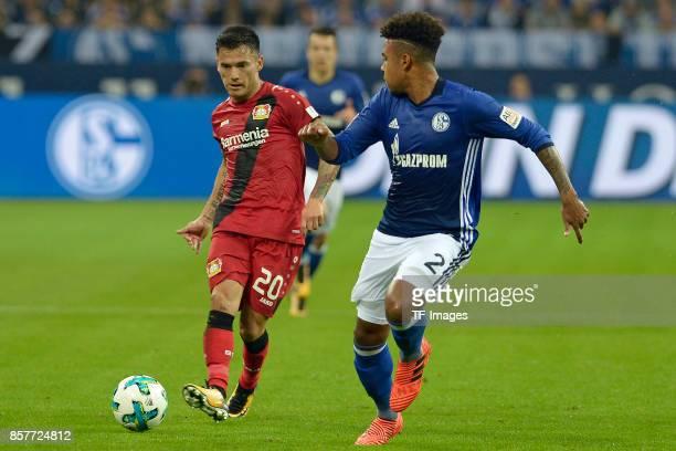 Charles Aranguiz of Leverkusen and Weston McKennie of Schalke battle for the ball during the Bundesliga match between FC Schalke 04 and Bayer 04...