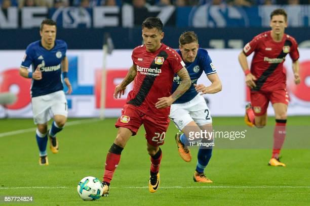 Charles Aranguiz of Leverkusen battle for the ball during the Bundesliga match between FC Schalke 04 and Bayer 04 Leverkusen at VeltinsArena on...