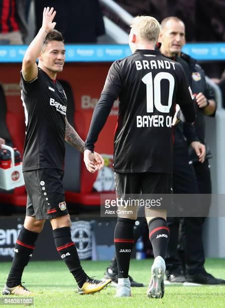 Charles Aranguiz of Leverkusen celebrates his team's second goal with team mate Julian Brandt during the Bundesliga match between Bayer 04 Leverkusen...