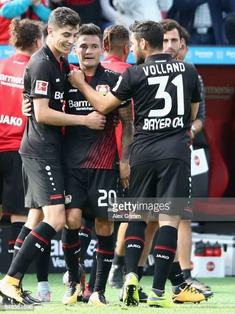 Charles Aranguiz of Leverkusen celebrates his team's second goal with team mates lvKai Havertz 8l9 and Kevin Volland during the Bundesliga match...