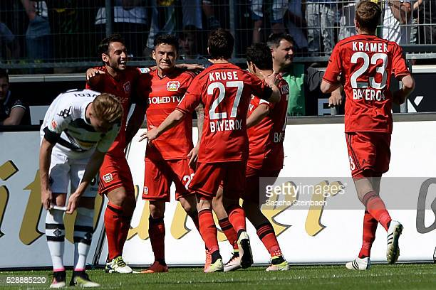 Charles Aranguiz of Leverkusen celebrates with team mates after scoring the opening goal during the Bundesliga match between Borussia...