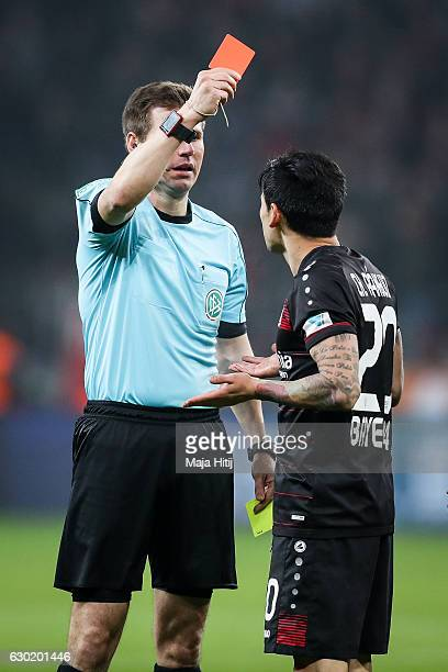 Charles Aranguiz of Leverkusen is shown a yellowred card by referee during the Bundesliga match between Bayer 04 Leverkusen and FC Ingolstadt 04 at...