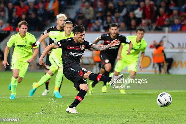 Charles Aranguiz of Leverkusen misses a penalty during the Bundesliga match between Bayer 04 Leverkusen and FC Augsburg at BayArena on September 21...