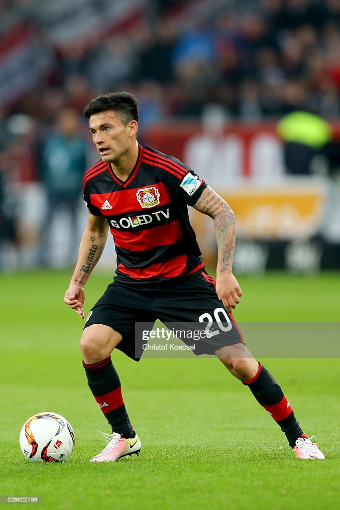 Charles Aranguiz of Leverkusen runs with the ball during the Bundesliga match between Bayer Leverkusen and Hertha BSC Berlin at BayArena on April 30, 2016 in Leverkusen, Germany.