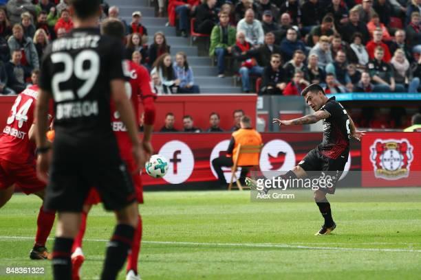 Charles Aranguiz of Leverkusen scores his team's second goal during the Bundesliga match between Bayer 04 Leverkusen and SC Freiburg at BayArena on...