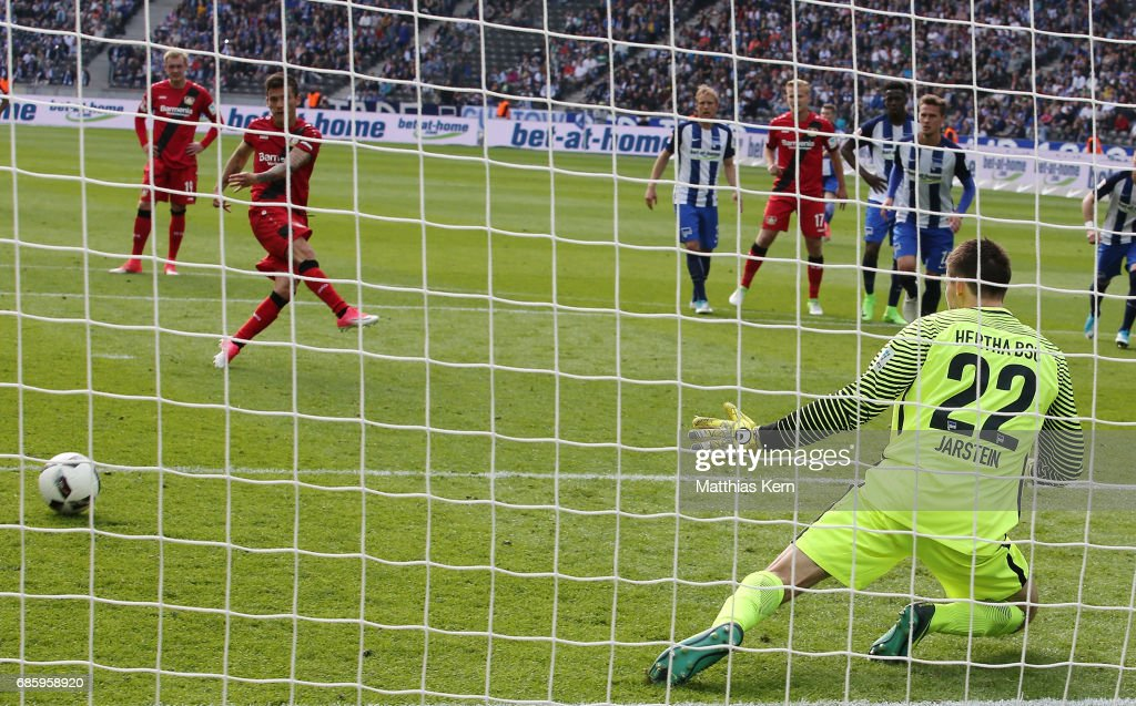 Charles Aranguiz (L) of Leverkusen scores the sixt goal after penalty during the Bundesliga match between Hertha BSC and Bayer 04 Leverkusen at Olympiastadion on May 20, 2017 in Berlin, Germany.