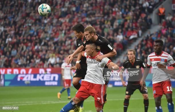 Charles Aranguiz of Leverkusen Sven Bender and Bobby Wood of Hamburg battle for the ball during the Bundesliga match between Bayer 04 Leverkusen and...