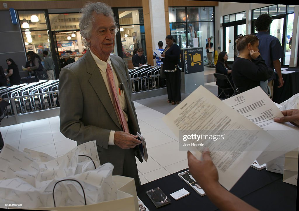 Charles B. Tally applies for a job at Calvin Klein during a job fair at Sawgrass Mills on October 11, 2013 in Sunrise, Florida. As the holiday season approaches many of the roughly 50 retailers at the job fair including Banana Republic, J.Crew Factory, Victoria's Secret and Calvin Klein are starting to hire people for seasonal work as well as continuing to look for qualified full time employees.