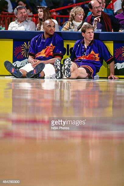 Charles Barkley and Danny Ainge of the Phoenix Suns look on against the Denver Nuggets circa 1994 at the McNichols Sports Arena in Denver Colorado...