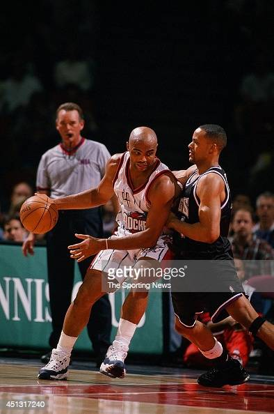 Charles Barkley of the Houston Rockets goes up against Corliss Williamson of the Sacramento Kings during the game on December 19 1997 at the Compaq...