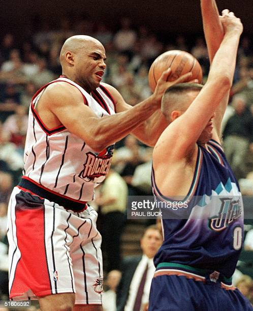Charles Barkley of the Houston Rockets grabs a rebound over Greg Ostertag of the Utah Jazz during first half action at Compaq Center 30 April 1999 in...