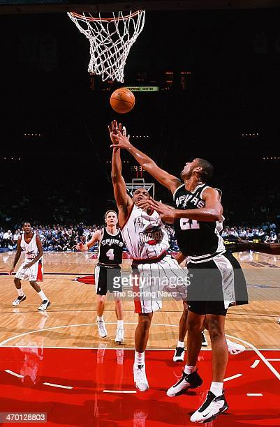 Charles Barkley of the Houston Rockets shoots against Tim Duncan of the San Antonio Spurs during the game on March 2 1999 at Compaq Center in Houston...