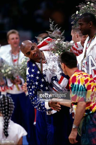 Charles Barkley of the Men's USA Basketball Team gets congratulations as he and his fellow original dream team teammates receive their gold medals...