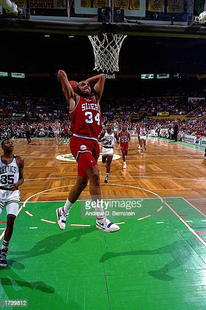 Charles Barkley of the Philadelphia 76ers soars in for a slam dunk during the 1989 NBA game against the Boston Celtics in the Boston Garden in Boston...
