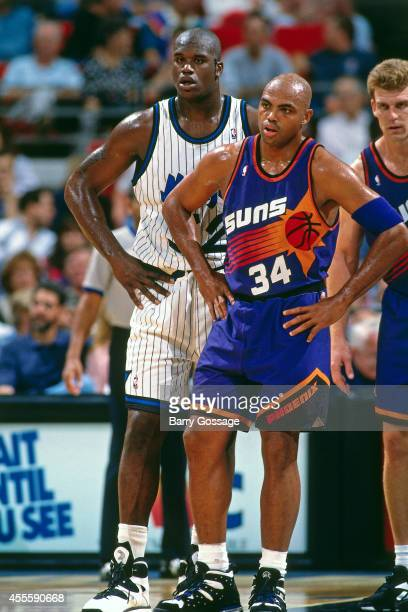 Charles Barkley of the Phoenix Suns and Shaquille O'Neal of the Orlando Magic stand circa 1995 at the Orlando Arena in Orlando Florida NOTE TO USER...