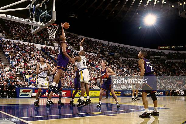 Charles Barkley of the Phoenix Suns blocks a shot attempt against the Golden State Warriors during a game played in 1993 at the OaklandAlameda County...