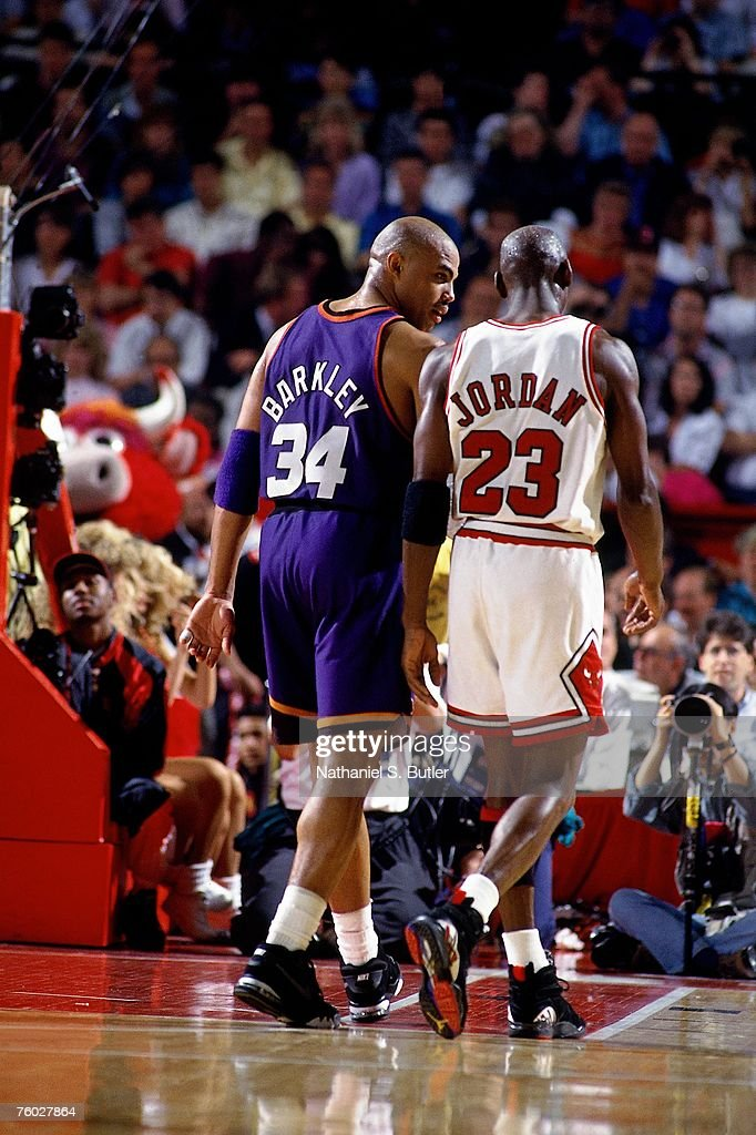 Charles Barkley of the Phoenix Suns chats with Michael Jordan of the Chicago Bulls in Game Five of the 1993 NBA Finals on June 18 1993 at the Chicago...