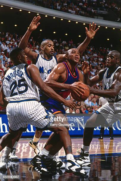 Charles Barkley of the Phoenix Suns drives against the Orlando Magic circa 1995 at the Orlando Arena in Orlando Florida NOTE TO USER User expressly...