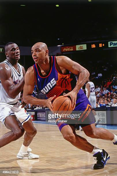 Charles Barkley of the Phoenix Suns drives against the Sacramento Kings circa 1993 at Arco Arena in Sacramento California NOTE TO USER User expressly...