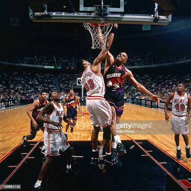 Charles Barkley of the Phoenix Suns dunks against Alonzo Mourning of the Miami Heat on January 30 1996 at the Miami Arena in Miami Florida NOTE TO...