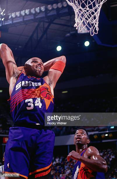 Charles Barkley of the Phoenix Suns dunks against the Sacramento Kings circa 1993 at Arco Arena in Sacramento California NOTE TO USER User expressly...