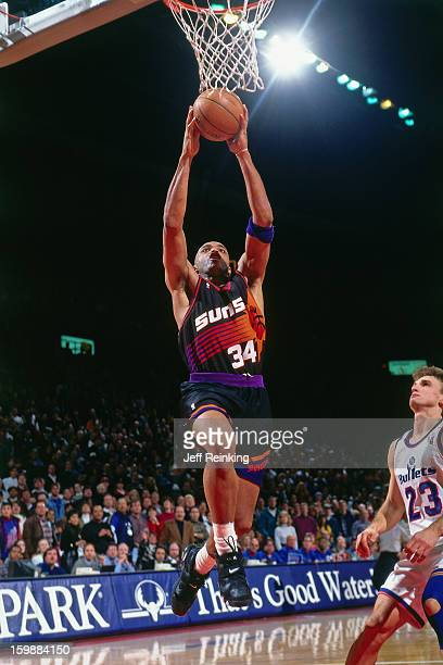 Charles Barkley of the Phoenix Suns dunks against the Washington Bullets on February 4 1996 at the Capitol Center in Landover Maryland NOTE TO USER...