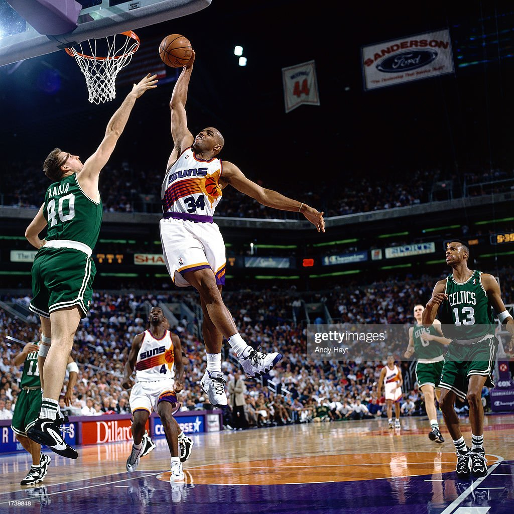 Charles Barkley of the Phoenix Suns goes for a dunk during the 1996 NBA game against the Boston Celtics at America West Arena in Phoenix Arizona NOTE...