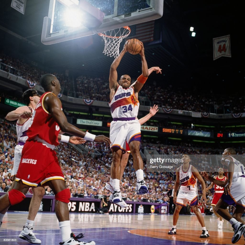 Charles Barkley of the Phoenix Suns grabs the rebound in Game Seven of the 1995 NBA Western Conference semifinals against the Houston Rockets on May...