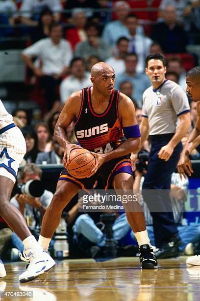 Charles Barkley of the Phoenix Suns handles the ball against the Orlando Magic on March 21 1995 at the Amway Arena in Orlando Florida NOTE TO USER...