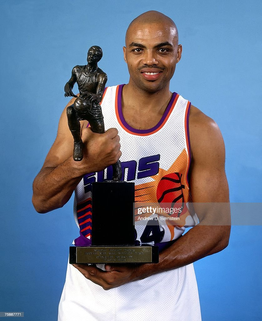 Charles Barkley of the Phoenix Suns poses for a photo with his 1993 NBA MVP trophy in Phoenix Arizona NOTE TO USER User expressly acknowledges that...