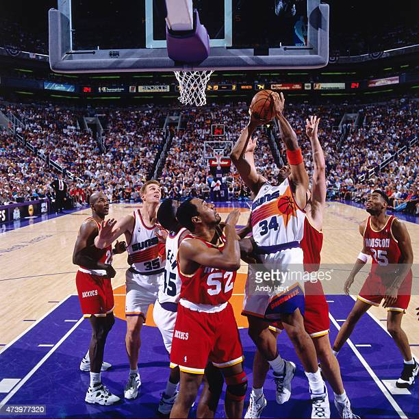 Charles Barkley of the Phoenix Suns shoots against the Houston Rockets during Game Seven of the Western Conference Semifinals on May 20 1995 at...
