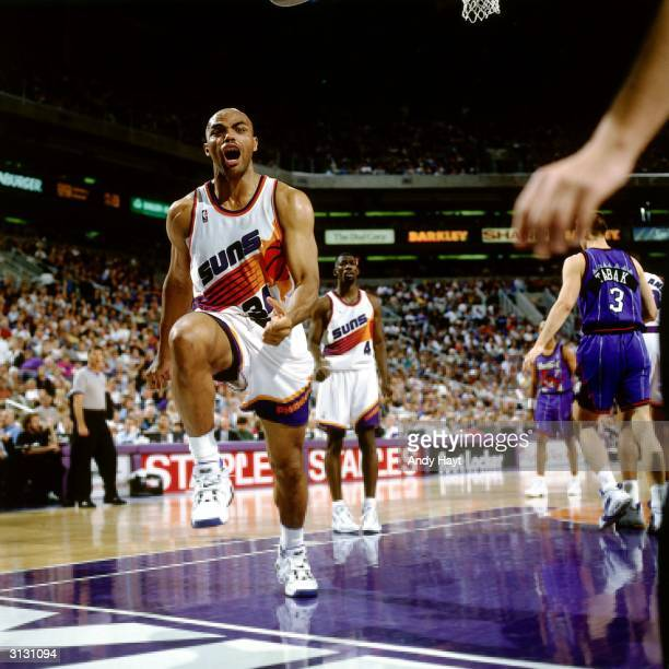 Charles Barkley of the Phoenix Suns shows emotion during an NBA game against the Toronto Raptors circa 1996 at America West Arena in Phoenix Arizona...