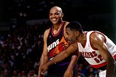 Charles Barkley of the Phoenix Suns smiles as Buck Williams of the Portland Trail Blazers prepares to box him out of the paint in Game Three of the...