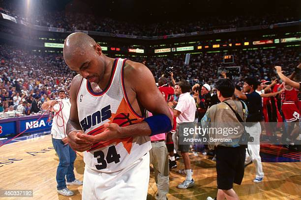 Charles Barkley of the Phoenix Suns walks off the court following Game Six of the 1993 NBA Finals on June 20 1993 at American West Arena in Phoenix...